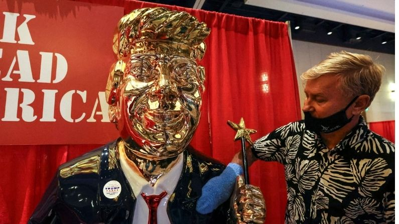 Trump's 'golden' effigy, magic wand in hand, shines at CPAC meeting despite criticisms and controversies
